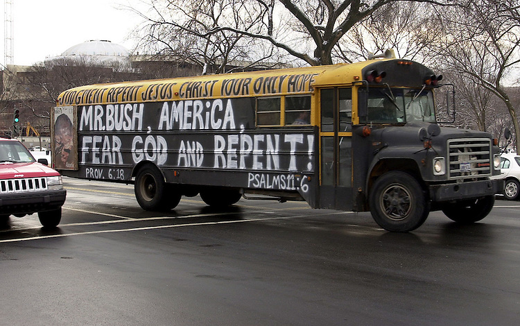 "bus012103 - A bus driven in circles around the Mall had speakers that said, ""Bush, give yourself to God. George W., repent, repent."""