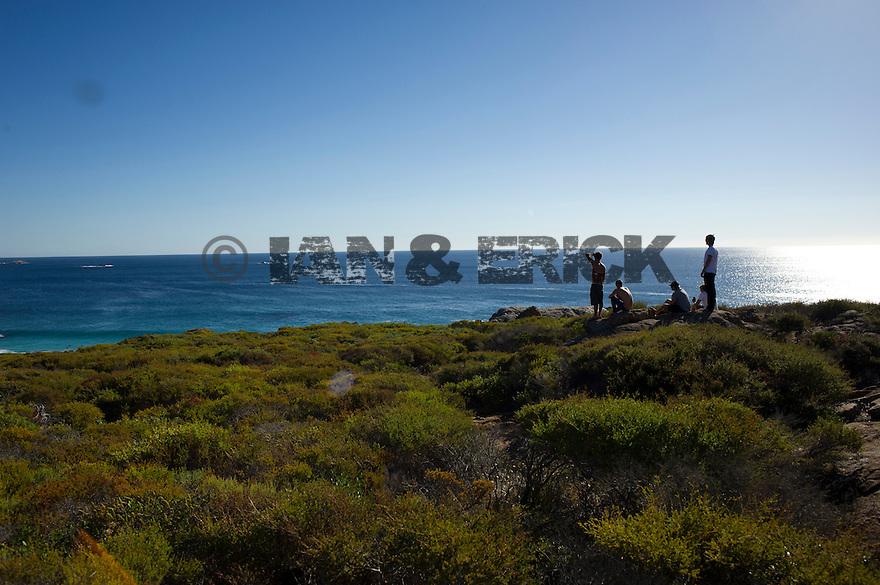 Ben Player, Shaggy, Spencer Skipper, James Wise and Mitch Rawlins watching supertube in Yallingup, Western Australia.