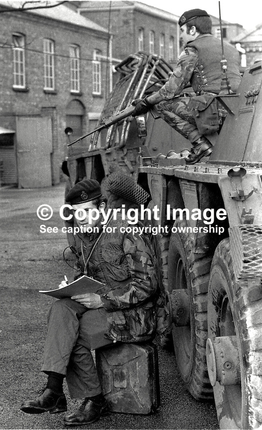 Major Chris Miers, the British Army's official war artist, at work in Belfast,  during the N Ireland Troubles. Whilst be sketches a bodyguard remains vigilant. Major Miers is serving with the Royal Green Jackets. 197211200731b.<br />