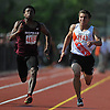 Jeremy Lissade, Mepham junior, left, and Carey senior Gregory Matzelle race down the stretch in the boys 100 meter dash during the Nassau County AA track and field championships at Glen Cove High School on Thursday, May 26, 2016.  Lissade won with a time of 10.85 while Matzelle crossed the finish line a mere two hundredths of a second later.