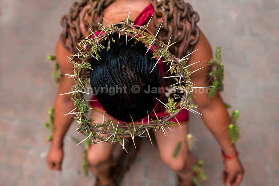 A chained Catholic penitent, wearing crown of thorns and cactus spines stuck to his body, prepares to participate in the Holy week procession in Atlixco, Mexico, 30 March 2018. Every year on Good Friday, dozens of anonymous men of all ages voluntarily undergo pain and suffering during the religious procession of the 'Engrillados' (the Shackled ones) in Puebla state, central Mexico. Wearing heavy chains on their shoulders covered with prickling cacti while being burned by the hot midday sun, they recall Jesus Christ's death by crucifixion and demonstrate their religiosity and faith.