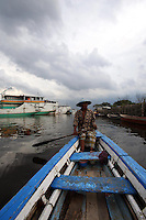A man rows his boat through the port area of northern Jakarta.<br /> <br /> To license this image, please contact the National Geographic Creative Collection:<br /> <br /> Image ID: 1588081 <br />  <br /> Email: natgeocreative@ngs.org<br /> <br /> Telephone: 202 857 7537 / Toll Free 800 434 2244<br /> <br /> National Geographic Creative<br /> 1145 17th St NW, Washington DC 20036