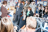 Republican presidential candidate Dr. Ben Carson stops by the New Hampshire State House Visitor Center after officially filing his presidential candidacy in Concord, New Hampshire. Traditionally candidates stop at the Visitor Center to sign the guestbook, put a campaign button or sticker up on the bulletin board, and put something in a time capsule. Carson put a stethoscope in the time capsule.