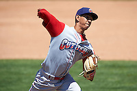 Williamsport Crosscutters pitcher Lewis Alezones (15) delivers a pitch during a game against the Batavia Muckdogs on July 16, 2015 at Dwyer Stadium in Batavia, New York.  Batavia defeated Williamsport 4-2.  (Mike Janes/Four Seam Images)