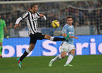 Giorgio Chiellini and  Senad Lulic    in action during the Italian Serie A soccer match between   SS Lazio and FC Juventus   at Olimpico  stadium in Rome , November 22, 2014