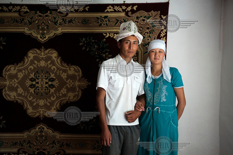 18 year old Cholpon with her new husband Aman a day after their wedding ceremony. Three days previously she was kidnapped byAman and taken to his home. Even if I married you, there would be no love in our married life.' Although illegal, bride kidnapping is common in rural parts of Kyrgyzstan. Each year around 16, 000 women become married after being kidnapped. They are known as 'Ala Kachuu' that translates as 'to grab and run away'. Defenders of the continuation of the practice sight tradition. However, during Soviet Times it was rare, and parents generally arranged marriages. Cholpon had seen Aman before but they had never spoken. She says: 'When I was taken to this house I kept resisting for 6 hours. But for a Kyrgyz woman once you enter a man's house it is very rude to leave and there were old women who kept convincing me to stay. It is our tradition to respect them. So I finally gave up.'...