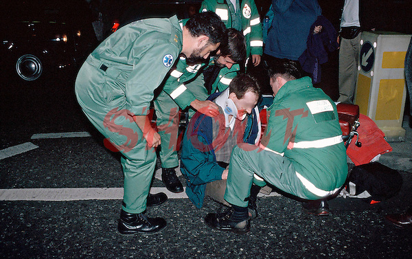 Paramedics attend a road traffic accident. The victim was trying to cross the road when a red London bus struck him. The victim has suffered head injuries and has had a neck collar fitted. This image may only be used to portray the subject in a positive manner..©shoutpictures.com..john@shoutpictures.com