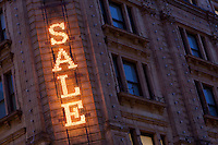 United Kingdom, London, Knightsbridge: illuminated Sale sign on facade of Harrods