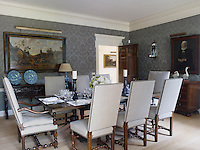 The formal dining room is hung with 17th century Dutch paintings