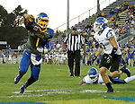 BROOKINGS, SD - OCTOBER 10:  Taryn Christion #1 from South Dakota State crosses the goal line for his first touchdown past Tsali Lough #3 from Indiana State in the first half of their game Saturday night at Coughlin Alumni Stadium. (Photo by Dave Eggen/Inertia)