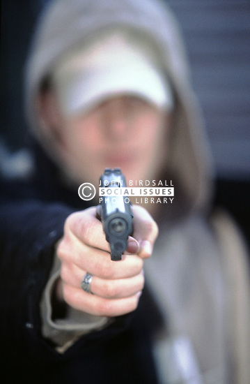 Youth with gun, UK Posed by model