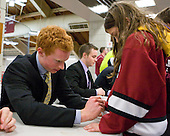 Mike Seward (Harvard - 18) signs a young fan's sweater. - The Yale University Bulldogs defeated the Harvard University Crimson 5-1 on Saturday, November 3, 2012, at Bright Hockey Center in Boston, Massachusetts.