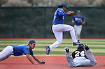 Western Nevada College's Tony Roque leaps out of the way as Connor Klein dives towards College of Southern Idaho's Nathan Ackerman during a college baseball game at John L. Harvey Field, in Carson City, Nev., on Friday, March 28, 2014. Klein had caught a line drive up the middle and was trying to double-up Ackerman. <br /> Photo by Cathleen Allison/Nevada Photo Source