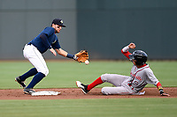 Second baseman Blake Tiberi (3) of the Columbia Fireflies gets the throw too late as Ricardo Cubillan (10) of the Greenville Drive steals second on Saturday, May 26, 2018, at Spirit Communications Park in Columbia, South Carolina. Columbia won, 9-2. (Tom Priddy/Four Seam Images)