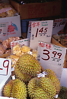Durian, an exotic fruit from Southeast Asian, on display at a Chinatown food market, Honolulu