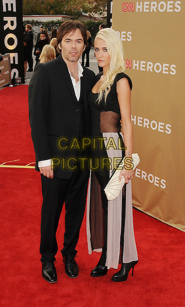 Billy Burke & Pollyanna Rose.CNN Heroes: An All-Star Tribute 2011 held at The Shrine Auditorium, Los Angeles, California, USA..December 11th, 2011.full length suit black white hands in pockets grey gray sheer dress married husband wife .CAP/ROT/TM.©Tony Michaels/Roth Stock/Capital Pictures