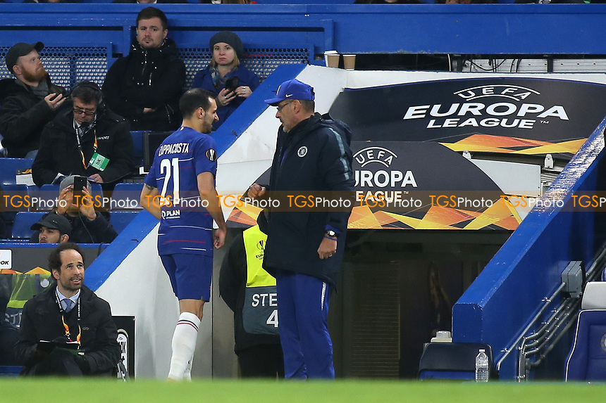 A frustrated Davide Zappacosta of Chelsea is substituted in the second half after suffering an injury and explains to manager, Maurizio Sarri, the problem during Chelsea vs PAOK Salonika, UEFA Europa League Football at Stamford Bridge on 29th November 2018