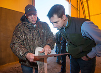 NWA Democrat-Gazette/BEN GOFF @NWABENGOFF<br /> Kevin White with the Arkansas Department of Environmental Quality, shows U.S. Sen. Tom Cotton aerial photos of the site Friday, Feb. 8, 2019, during a tour of the stump dump fire site in Bella Vista.