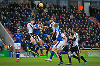 Rochdale's Jim McNulty jumps to clear the ball (L) during the Sky Bet League 1 match between Oldham Athletic and Rochdale at Boundary Park, Oldham, England on 18 November 2017. Photo by Juel Miah/PRiME Media Images
