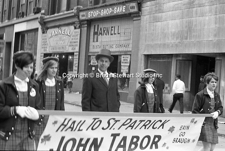 Pittsburgh PA:  View of the annual Pittsburgh Saint Patrick's Day parade on Fifth Avenue - 1969.  View is uptown near the intersection with 6th Street. All the local politicians and judges were actively involved in the festivities.