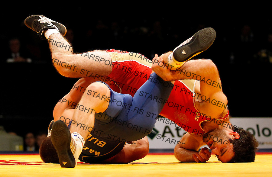 BELGRADE, SERBIA - MARCH 06: Alan Gogaev of Russia (R) competes for the gold medal  with Leonid Bazan (L) of Men's Freestyle 66kg during the European wrestling championship March 06, 2011 in Belgrade, Serbia.(Photo by Srdjan Stevanovic/Getty Images)