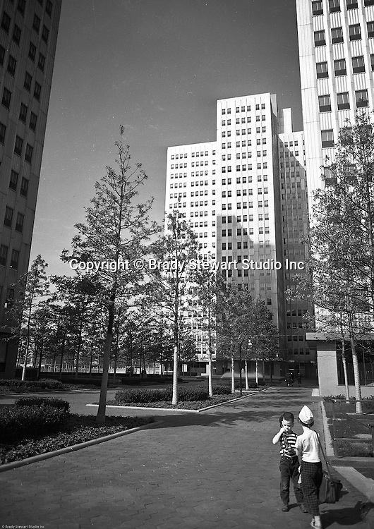 Pittsburgh PA:  View of Gateway Center building One and landscaping - 1953.  Cathy and Brady III assisting dad on the assignment. Gateway Center, a four-building office campus that is a centerpiece of the Downtown Pittsburgh business district. Serving as the key piece of Pittsburgh's Renaissance 1,  Gateway Center and the original Pittsburgh Hilton shaped the Pittsburgh Point for over 30 years. Gateway Center totals nearly 1.5 million square feet of space on 8.9 acres, along with the complementing landscaped plaza, underground walkways and parking.