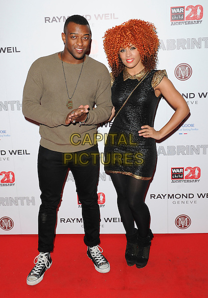 Oritse Williams of JLS & guest .Attending the Raymond Weil Pre-Brit Awards Dinner and 20th anniversary celebration of War Child at Mosaica, Wood Green, London, UK, .January 24th 2013..full length brown jumper necklace dog tag  trainers converse .CAP/GM/PP.©Gary Mitchell/PP/Capital Pictures