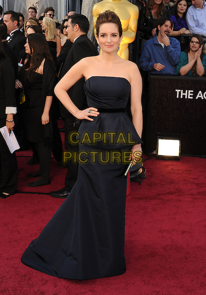 Tina Fey.Arrivals to the 84th Annual Academy Awards held at The Theatre at Hollywood & Highland Centre in Hollywood, California, USA. .February 26th, 2012.oscars full length blue dress black strapless dress peplum hand on hip.CAP/ROT/TM.©Tony Michaels/Roth Stock/Capital Pictures