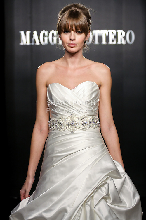Model walks the runway in a Monterey Couture wedding dress from the Maggie Sottero Bridal Spring 2012 collection, during  Couture: New York Bridal Fashion Week 2012