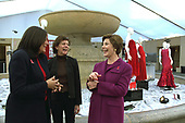 """First lady Laura Bush shares a light moment with Fern Mallis of 7th on Sixth, left, and Lynn Long, chief of Fashion Week production, after reviewing the designer dresses on display for """"The Red Dress Project"""" in Bryant Park in New York City Friday, February 14, 2003. """"The Red Dress Project"""" is part of the Heart Truth campaign to raise awareness of heart disease as the number one killer of women.  The dresses were created by 19 American designers and will tour for one year and then be auctioned to benefit the American Heart Association. <br /> Mandatory Credit: Susan Sterner / White House via CNP"""