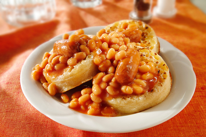 Baked beans on buttered crumpets stock photos