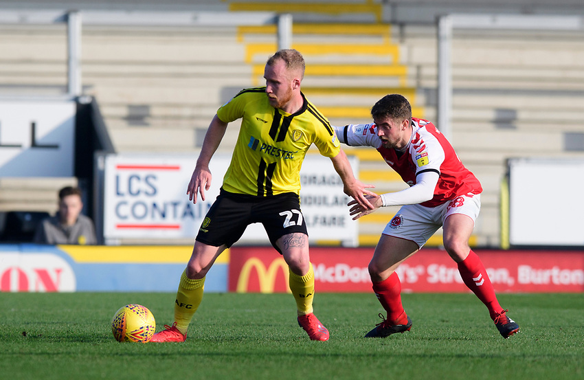 Burton Albion's Liam Boyce shields the ball from Fleetwood Town's Jack Sowerby<br /> <br /> Photographer Chris Vaughan/CameraSport<br /> <br /> The EFL Sky Bet League One - Saturday 23rd February 2019 - Burton Albion v Fleetwood Town - Pirelli Stadium - Burton upon Trent<br /> <br /> World Copyright © 2019 CameraSport. All rights reserved. 43 Linden Ave. Countesthorpe. Leicester. England. LE8 5PG - Tel: +44 (0) 116 277 4147 - admin@camerasport.com - www.camerasport.com