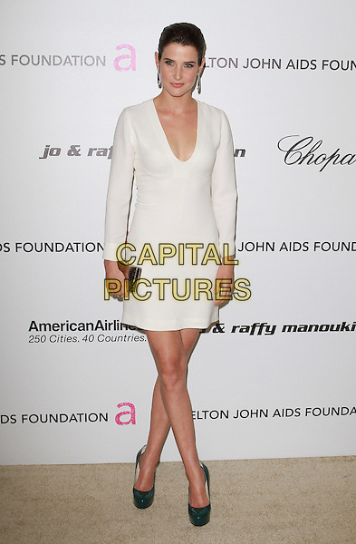 COBIE SMULDERS.19th Annual Elton John AIDS Foundation Academy Awards Viewing Party held at The Pacific Design Center, West Hollywood, California, USA..February 27th, 2011.oscars full length white dress long sleeves clutch bag silver clutch bag green shoes .CAP/ADM/FS.©Faye Sadou/AdMedia/Capital Pictures.