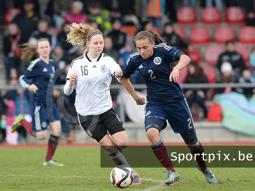 20150404 - FORST , GERMANY  : Scottish Abigail Harrison pictured with German Saskia Matheis (16)  during the soccer match between Women Under 19 teams of Germany and Scotland , on the first matchday in group 5 of the UEFA Elite Round Women Under 19 at WaldseeStadion , Forst , Germany . Saturday 4th April 2015 . PHOTO DAVID CATRY