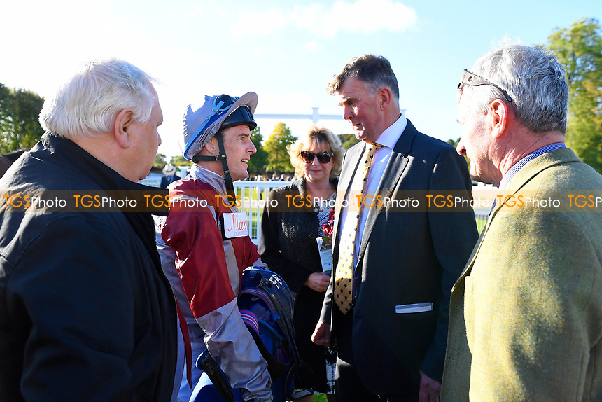 Jockey of Beyond Equal Fran Berry with connections in the Winners Enclosure after winning The Booker Ltd Handicap Stakes      during Afternoon Racing at Salisbury Racecourse on 3rd October 2018