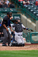 Kane County Cougars catcher Jose Herrera (8) in front of umpire Thomas Burrell during a Midwest League game against the Fort Wayne TinCaps at Parkview Field on May 1, 2019 in Fort Wayne, Indiana. Fort Wayne defeated Kane County 10-4. (Zachary Lucy/Four Seam Images)