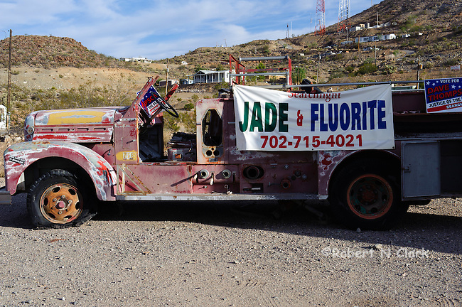 Old truck carrying advertising banner
