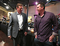NWA Democrat-Gazette/J.T. WAMPLER Bob Stoops, former Oklahoma head football coach,(left) visits with a former player Matt McCoy of Tulsa Wednesday Oct. 11, 2017 at the NWA Touchdown Club in Fayetteville. McCoy played at Oklahoma from 1999-2003.