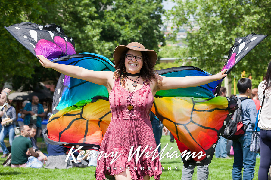 Girl waving multicolored butterfly wings, NW Folklife Festival, Seattle, WA, USA.