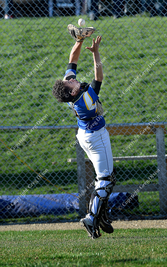 Madison West catcher, Drake Baldwin, catches a foul ball behind home plate in the bottom of the fifth inning, as Memorial tops West 2-0 in Big Eight Conference high school baseball on Tuesday, 4/23/19 at Mansfield Stadium field at Memorial High School in Madison, Wisconsin