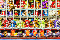 Stuffed animals prizes at a carnival booth game.