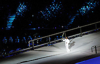 15 MAR 2006 - MELBOURNE, AUS - Cathy Freeman carries the torch into the MCG for the Opening Ceremony of the 2006 Commonwealth Games (PHOTO (C) NIGEL FARROW)