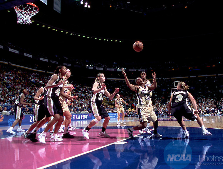 01 APR 2001:  Guard Niele Ivey (33) of Notre Dame chases down a loose ball against Purdue during the Division 1 Women's Basketball Championships held at the Savvis Center in St. Louis, MO.  Notre Dame defeated Purdue 68-66 for the national championship title.  Jamie Schwaberow/NCAA Photos