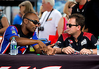 Aug. 31, 2013; Clermont, IN, USA: NHRA top fuel dragster driver Antron Brown (left) talks with Steve Torrence during qualifying for the US Nationals at Lucas Oil Raceway. Mandatory Credit: Mark J. Rebilas-