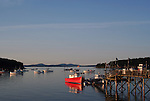 sailboats and fishing boats in bar harbor near sunset