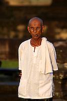 An old man leaves Angkor Wat at sunset, Cambodia