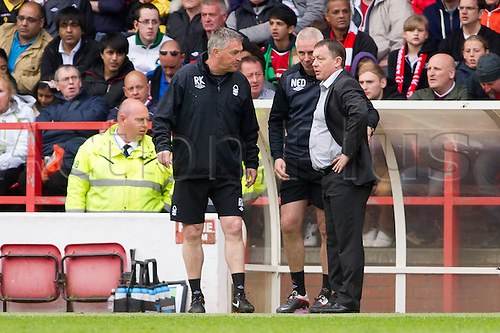 04.05.2013 Nottingham, England.  Nottingham Forest's Manager Billy Davies discusses tactics with his technical team during the Championship game between Nottingham Forest and Leicester City from the City Ground.