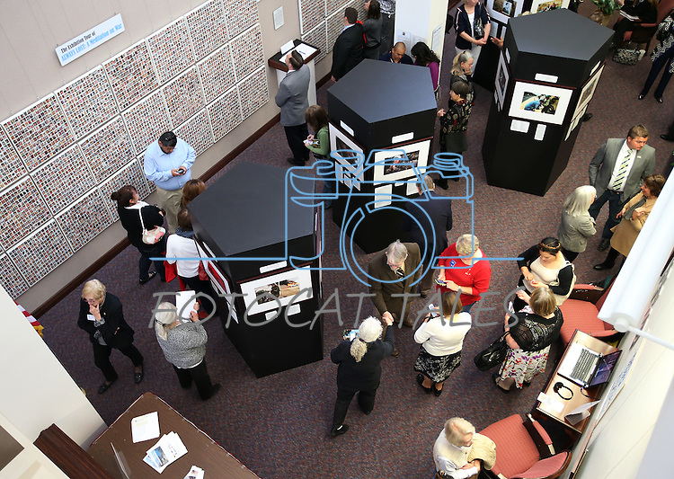 Visitors look at the Always Lost: A Meditation on War exhibit at the Legislative Building in Carson City, Nev., on Monday, April 6, 2015. <br />