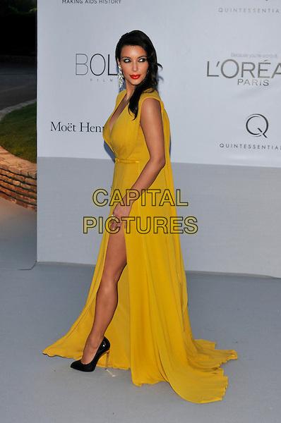 Kim Kardashian.AmFAR Cinema Against AIDS 2012, Hotel du Cap, Antibes during the 65th  Cannes Film Festival, France..24th May 2012.full length yellow sleeveless dress slit split side.CAP/PL.©Phil Loftus/Capital Pictures.