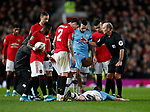 Players from both teams gather round as Kevin De Bruyne of Manchester City goes down following a clash with Victor Lindelof of Manchester United during the Carabao Cup match at Old Trafford, Manchester. Picture date: 7th January 2020. Picture credit should read: Darren Staples/Sportimage